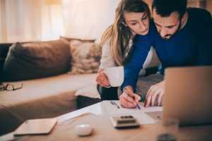 a couple working on papers | Be Informed Home Inspections | buy a home Dallas