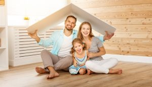 family under cardboard roof | Be Informed Home Inspections | New roofing Dallas
