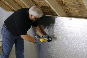 contractor works on the attic | Be Informed Home Inspections | energy bills Fort Worth