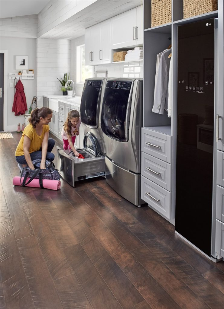 mother and child doing laundry   Be Informed Inspections   Household routine Dallas